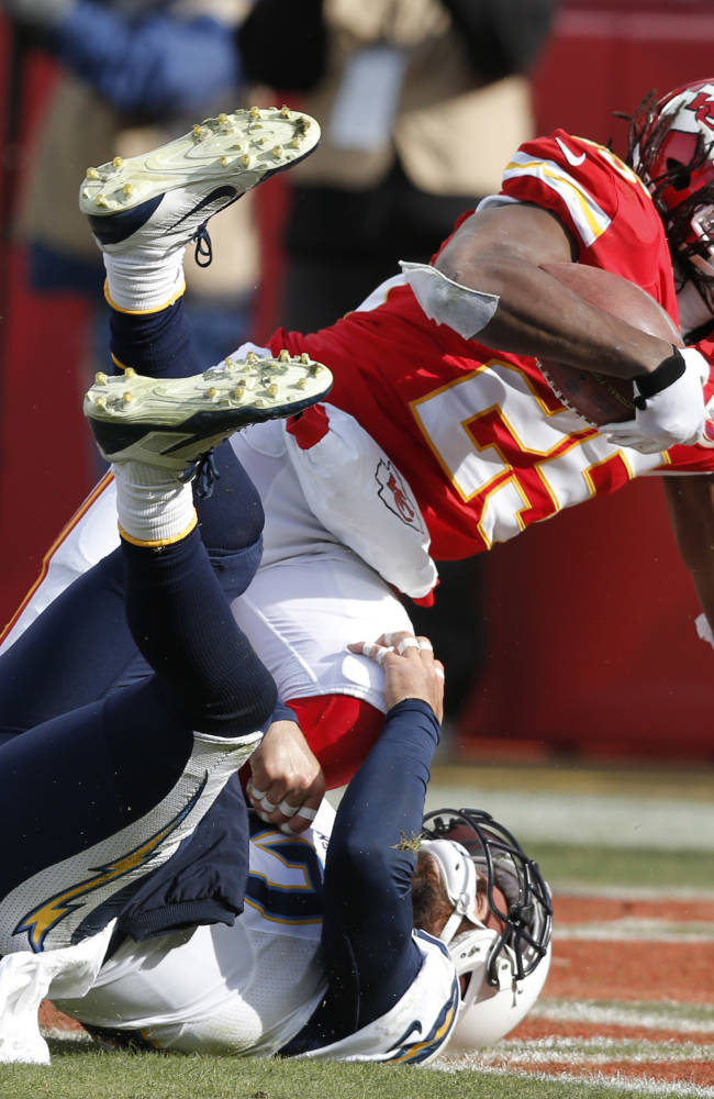 Kansas City Chiefs running back Jamaal Charles (25) scores a touchdown over San Diego Chargers free safety Eric Weddle during the first half of an NFL football game at Arrowhead Stadium in Kansas City, Mo., Sunday, Nov. 24, 2013