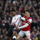 Arsenal's Laurent Koscielny, right, competes with Liverpool's Daniel Sturridge during their English FA Cup fifth round soccer match at Emirates Stadium in London, Sunday, Feb. 16, 2014