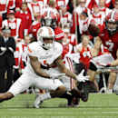 Wisconsin's Michael Caputo breaks up a pass intended for Bowling Green's Roger Lewis (1) during the first half of an NCAA college football game, Saturday, Sept. 20, 2014, in Madison, Wis The Associated Press