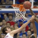 Kansas center Jeff Withey (5) blocks a shot by San Jose State forward Chris Cunningham (15) during the first half of an NCAA college basketball game in Lawrence, Kan., Monday, Nov. 26, 2012. (AP Photo/Orlin Wagner)