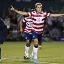 Stuart Holden celebrates his second half goal against Belize in in the CONCACAF Gold Cup at Jeld-Wen Field, Tuesday July 9, 2013, in Portland, Ore. (AP Photo/The Oregonian, Thomas Boyd)