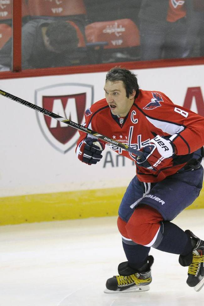 Washington Capitals right wing Alex Ovechkin (8), of Russia, skates during warm ups before an NHL hockey game against the New York Islanders, Tuesday, Nov. 5, 2013, in Washington