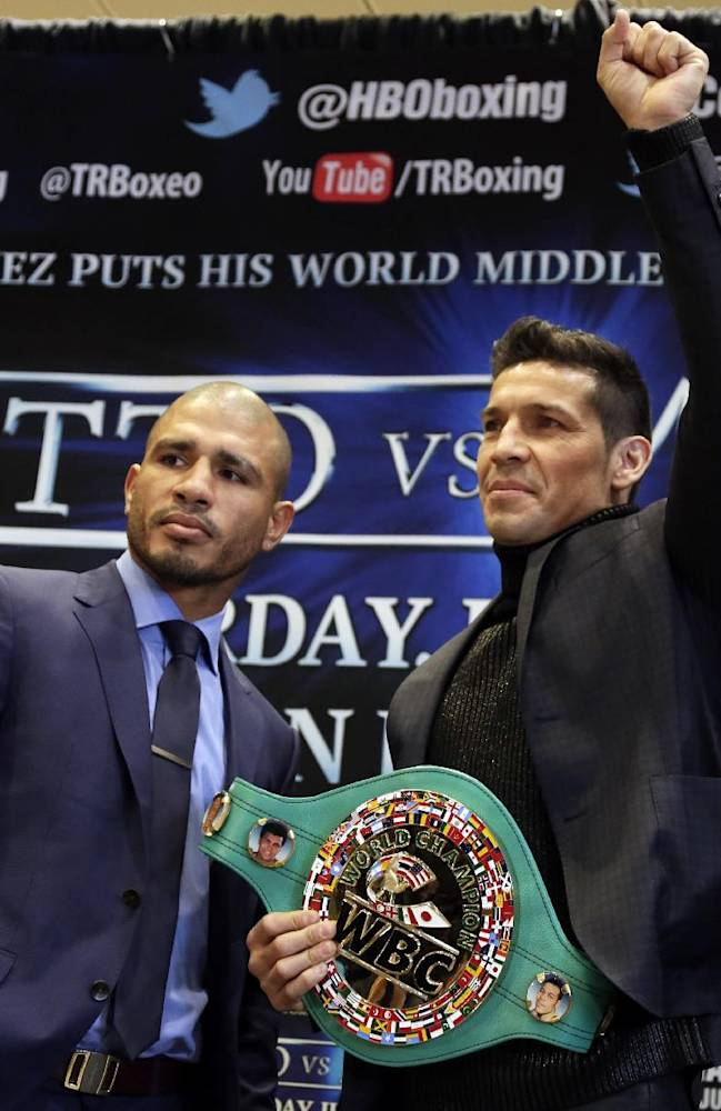 WBC middleweight champion Sergio Martinez, right, of Argentina, and challenger Miguel Cotto, of Puerto Rico, pose for photos during a news conference in New York's Madison Square Garden, Tuesday, March 11, 2014, to promote their scheduled June 7, 2014, bout