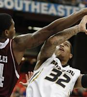 Missouri guard Jabari Brown (32) shoots against Texas A&M forward Tavario Miller (4) during the first half of an NCAA college basketball game in the second round of the Southeastern Conference men's tournament game, Thursday, March 13, 2014, in Atlanta. (AP Photo/John Bazemore)