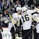 The Pittsburgh Penguins celebrate a goal by Brandon Sutter during the second period of an NHL hockey game against the Colorado Avalanche on Sunday, April 6, 2014, in Denver. The Penguins won in a shootout, 3-2 The Associated Press