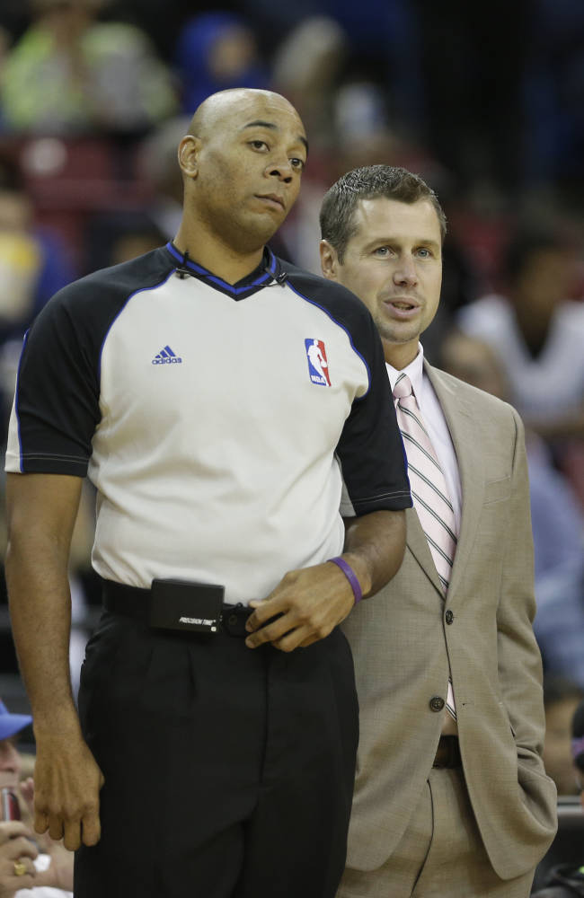 Memphis Grizzlies head coach David Joerger, right, talks with Official Karl Lane during the first quarter against the Sacramento Kings in an NBA basketball game in Sacramento, Calif., Sunday, Nov. 17, 2013. The Grizzlies won 97-86