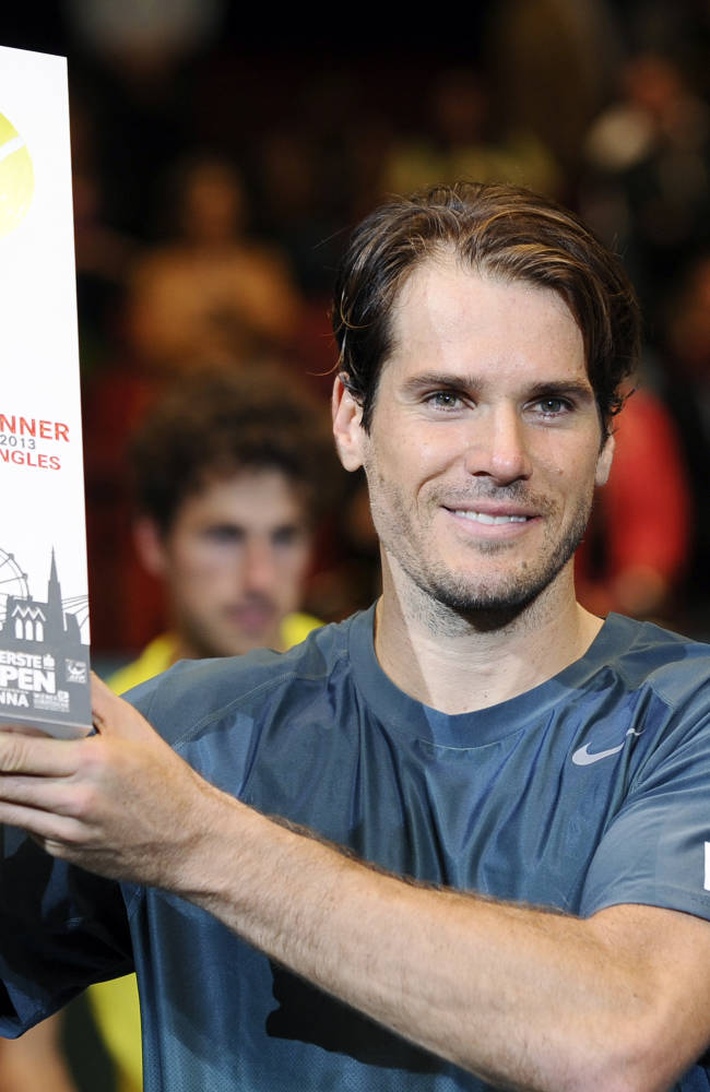 Tommy Haas of Germany poses with the trophy after winning the final match against Robin Haase of the Netherlands at the Erste Bank Open tennis tournament in Vienna, Austria, Sunday, Oct. 20, 2013