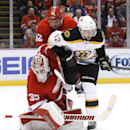Boston Bruins' Simon Gagne (12) collides with Detroit Red Wings goalie Jimmy Howard (35) in the first period of an NHL hockey game in Detroit, Wednesday, Oct. 15, 2014 The Associated Press