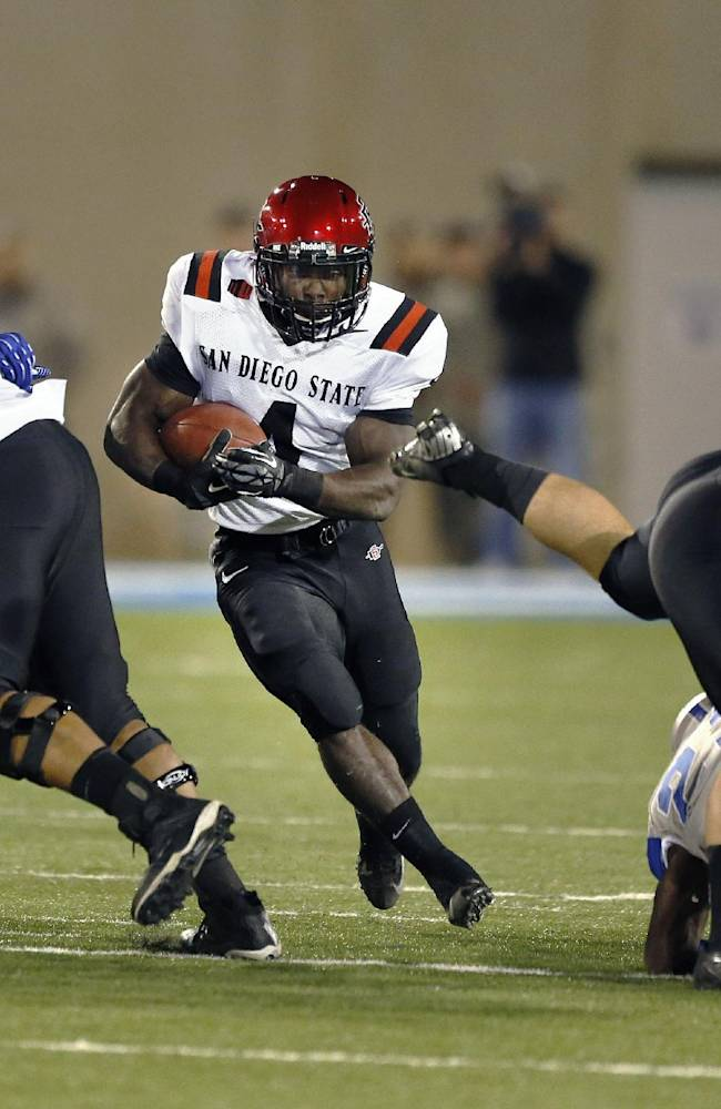 San Diego State running back Adam Muema finds a hole as he runs with the ball during the first quarter of an NCAA college football game against Air Force, at the Air Force Academy, Colo. Thursday, Oct. 10, 2013