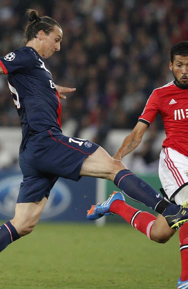PSG's Zlatan Ibrahimovic, left, challenges for the ball with Benfica's Ezequiel Garay during the Champions League group C soccer match between PSG and Benfica, at the Parc des Princes stadium, in Paris, Wednesday, Oct. 2, 2013