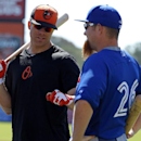 Baltimore Orioles' Chris Davis, left, and Toronto Blue Jays' Adam Lind (26) talk before an exhibition spring training baseball game in Sarasota, Fla., Saturday, March 1, 2014 The Associated Press