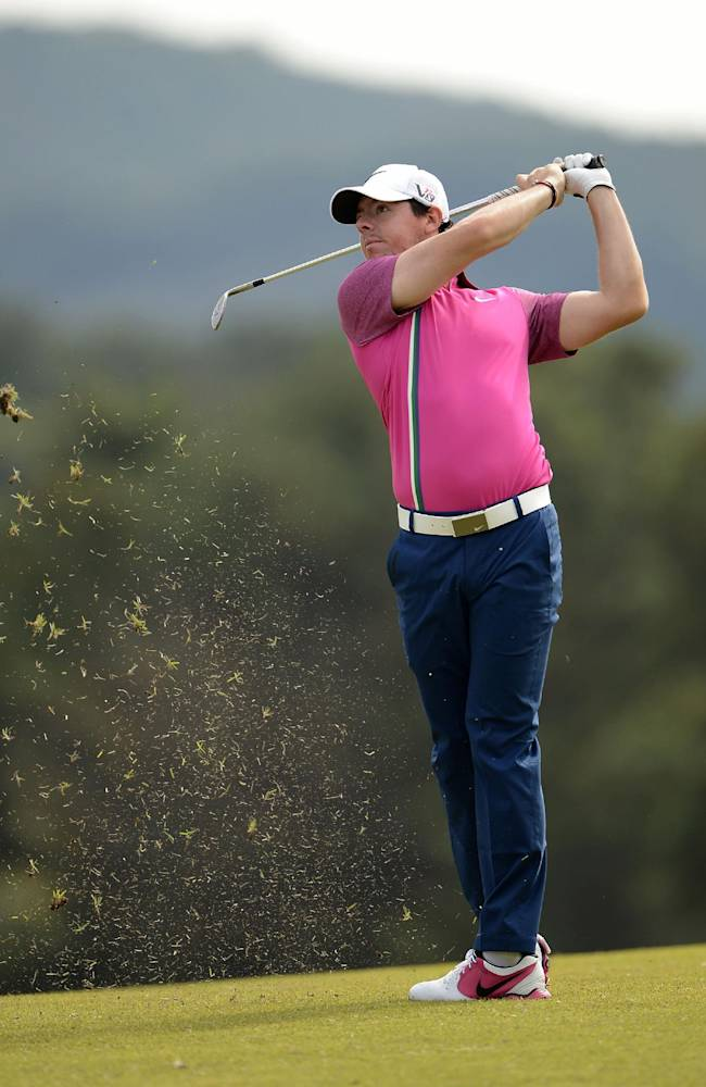 In this photo released by OneAsia, Rory McIlroy of Northern Ireland watches his shot during the third round of the Korea Open golf tournament at Woo Jeong Hills Country Club near Cheonan, South Korea, Saturday, Oct. 19, 2013