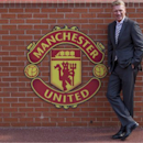 Manchester United's new manager David Moyes poses for pictures before a press conference, at Old Trafford Stadium, Manchester, England, Friday July 5, 2013. New Manchester United manager David Moyes says Wayne Rooney will remain with the Premier League champions and won't be sold. The England striker had indicated before the end of last season, before manager Alex Ferguson retired, that he wanted to leave United after nine years. (AP Photo/Jon Super)