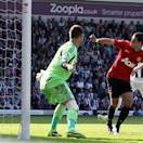 Manchester United's Javier Hernandez scores against West Bromwich Albion during their English Premier League soccer match at the Hawthorns, West Bromwich, England, Sunday May 19, 2013. (AP Photo/PA, Nick Potts)