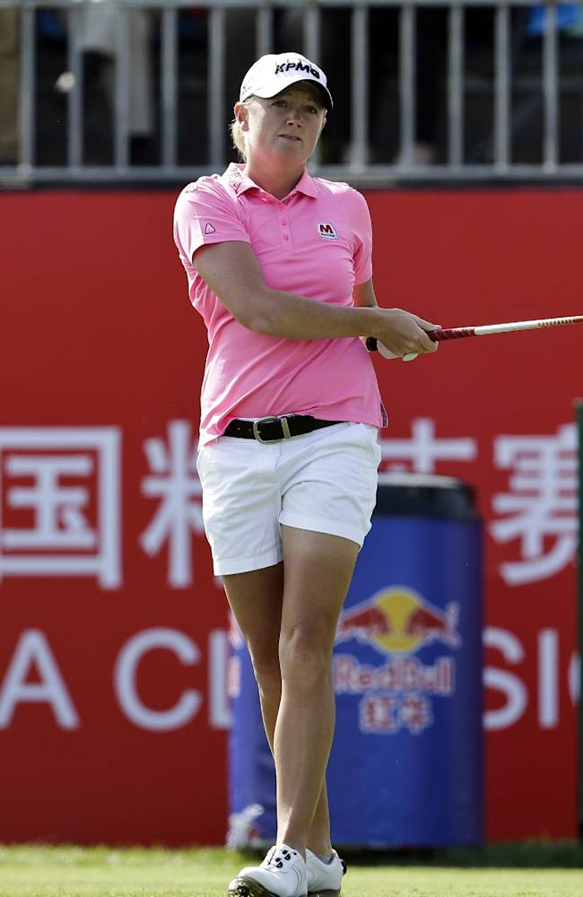 Stacy Lewis of the United States follows her ball after teeing off on the first hole during the first round of the Reignwood LPGA Classic golf tournament at Pine Valley Golf Club on the outskirts of Beijing, China, Thursday, Oct. 3, 2013