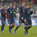 Bayern players walk on the pitch after the Champions League group D soccer match between FC Bayern Munich and Manchester City, in Munich, southern Germany, Tuesday, Dec. 10, 2013. (AP Photo/Matthias Schrader)