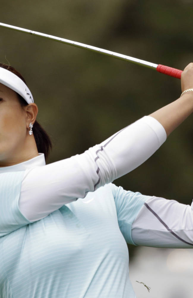 Michelle Wie hits her fourth shot from the first fairway of the Lake Merced Golf Club during the first round of the Swinging Skirts LPGA Classic golf tournament on Thursday, April 24, 2014, in Daly City, Calif