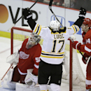 Boston Bruins left wing Milan Lucic (17) celebrates his goal on Detroit Red Wings goalie Jonas Gustavsson (50) during the third period of Game 4 of a first-round NHL hockey playoff series in Detroit, Thursday, April 24, 2014 The Associated Press