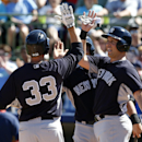 New York Yankees' Kelly Johnson (33) and Mark Teixeira (25) celebrate Johnson's two-run home run in the third inning of a exhibition baseball game against the Houston Astros, Saturday, March 8, 2014, in Kissimmee, Fla The Associated Press