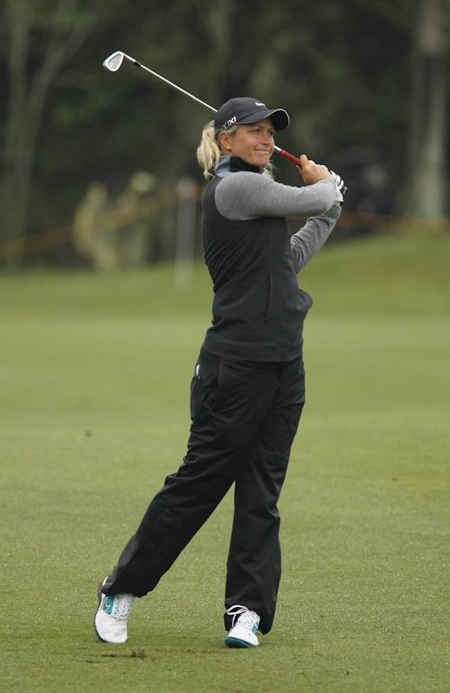 Suzann Pettersen of Norway, reacts to her drive on the 17th hole fairway during the first day of the Sunrise LPGA Taiwan Championship tournament at the Sunrise Golf & Country Club, Thursday, Oct. 24, 2013, in Yangmei, northeastern Taiwan. Pettersen finished in first position after carding a 68 with four strokes under par