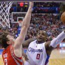 Los Angeles Clippers forward Glen Davis, right, puts up a shot Houston Rockets center Omer Asik, of Turkey, defends during the second half of an NBA basketball game, Wednesday, Feb. 26, 2014, in Los Angeles The Associated Press