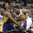 Sacramento Kings forward Rudy Gay, right, goes to the basket against Los Angeles Lakers guard Nick Young during the fourth quarter of an NBA basketball game Wednesday, April 2, 2014, in Sacramento, Calif. The Kings won 107-102 The Associated Press