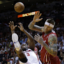 Detroit Pistons' Rodney Stuckey (3) commits an offensive foul as he attempts a shot over Miami Heat's Chris Andersen, right, during the second half of an NBA basketball game, Tuesday, Dec. 3, 2013, in Miami. The Pistons won 107-97 The Associated Press