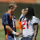 Denver Broncos quarterback Peyton Manning (18) and Houston Texans free safety Kendrick Lewis (21) shake hands following a joint practice between the Broncos and Texans on Tuesday, Aug. 19, 2014, in Englewood, Colo The Associated Press