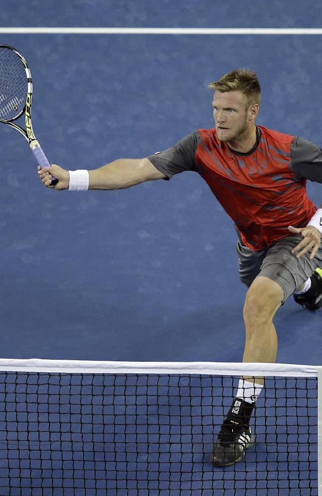 Sam Groth, of Australia, returns a shot to Roger Federer, of Switzerland, during the second round of the 2014 U.S. Open tennis tournament Friday, Aug. 29, 2014, in New York