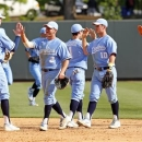 FILE - In this April 21, 2013 file photo, North Carolina players celebrate their 10-1 win over Duke in an NCAA college baseball game in Chapel Hill, N.C. If there's a blueprint to survive in this new college baseball world of pitching and defense, it looks like the Tar Heels and Tigers have found it. (AP Photo/Karl B DeBlaker, File)