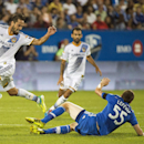 Montreal Impact's Wandrille Lefevre (55) and L.A. Galaxy's Marcelo Sarvas, left, battle for the ball during the second half of a soccer game, Wednesday, Sept. 10, 2014 in Montreal The Associated Press