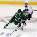 Dallas Stars center Tyler Seguin (91) and Chicago Blackhawks center Marcus Kruger (16), of Sweden, fight for position in the third period of an NHL hockey game Tuesday, Dec. 10, 2013, in Dallas The Associated Press