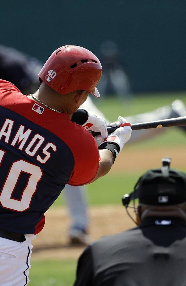 Washington Nationals' Wilson Ramos grounds into a force out to score teammate Anthony Rendon in the first inning of an exhibition spring training baseball game against the New York Yankees, Tuesday, March 11, 2014, in Viera, Fla