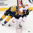 Philadelphia Flyers forward Steve Downie (9) and Nashville Predators forward Patric Hornqvist (27), of Sweden, battle for the puck in the second period of an NHL hockey game Saturday, Nov. 30, 2013, in Nashville, Tenn The Associated Press
