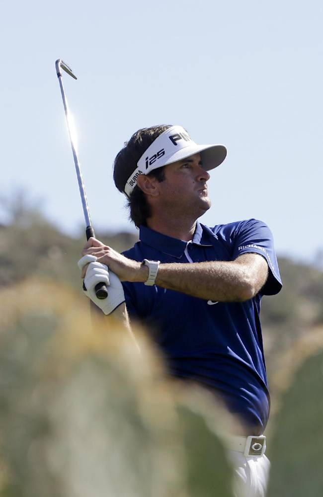 Bubba Watson watches his tee shot on the 16th hole in his second-round match against Jonas Blixt, of Sweden, at the Match Play Championship golf tournament on Thursday, Feb. 20, 2014, in Marana, Ariz