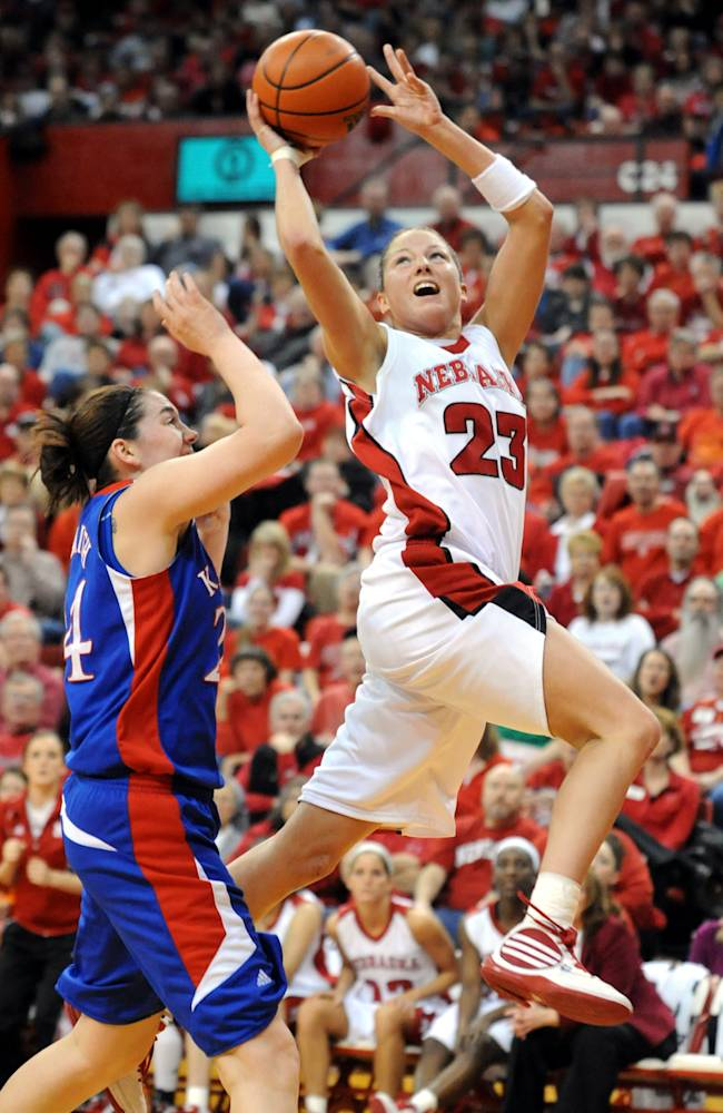 In this March 3, 2010 file photo, Nebraska's Kelsey Griffin (23) takes a shot over Kansas' Nicollette Smith (24) during an NCAA college basketball game in Lincoln, Neb. Former Nebraska women's basketball star Kelsey Griffin will have her No. 23 jersey retired in January. Nebraska announced Wednesday, Nov. 6, 2013,  that Griffin, who plays in the WNBA and Australia, will be honored Jan. 29 when the Huskers host Michigan
