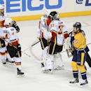 Calgary Flames left wing Brandon Bollig, left, defenseman Kris Russell (4), center Sean Monahan (23), and goalie Karri Ramo, of Finland, celebrate as Nashville Predators center Olli Jokinen (13) skates by after the Calgary Flames won the game 3-2 during a