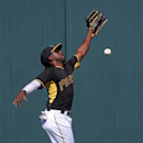 Pittsburgh Pirates center fielder Andrew McCutchen can't get to a ball hit over his head for a double by Boston Red Sox's A.J. Pierzynski during the fifth inning of an exhibition spring training baseball game in Bradenton, Fla., Monday, March 3, 2014. The