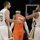 New York Knicks forward Carmelo Anthony (7) leaves the court as New Orleans Pelicans forward Ryan Anderson (33) and New Orleans Pelicans guard Eric Gordon (10) celebrate after defeating the Knicks 103-99 in their NBA basketball game at Madison Square Gard