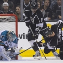 Los Angeles Kings left wing Kyle Clifford (13) and center Anze Kopitar (11) look to score against San Jose Sharks goalie Antt