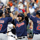 Cleveland Indians' Mike Aviles, center, celebrates with Matt Carson (7) and Michael Brantley (23) after hitting a grand slam to take a 4-0 lead over the Detroit Tigers in the ninth inning of a baseball game on Sunday, Sept. 1, 2013, in Detroit. (AP Photo/Duane Burleson)