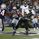 Baltimore Ravens wide receiver Steve Smith (89) catches a nine-yard touchdown pass in front of New England Patriots cornerback Darrelle Revis (24) in the first half of an NFL divisional playoff football game Saturday, Jan. 10, 2015, in Foxborough, Mass Th