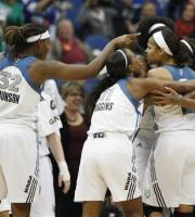Minnesota Lynx forward Rebekkah Brunson (32) points to forward Maya Moore (23) as they celebrate with teammates after a play against the Los Angeles Sparks in the first half of Game 1 of the WNBA basketball Western Conference Finals Thursday, Oct. 4, 2012, in Minneapolis. The Lynx 94-77. (AP Photo/Stacy Bengs)