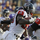 Atlanta Falcons running back Steven Jackson (39) tries to break a tackle by Minnesota Vikings outside linebacker Gerald Hodges (50) during the second half of an NFL football game, Sunday, Sept. 28, 2014, in Minneapolis. The Associated Press