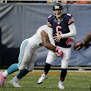 Miami Dolphins defensive end Cameron Wake (91) strips the ball forcing Chicago Bears quarterback Jay Cutler (6) to fumble during the second half of an NFL football game Sunday, Oct. 19, 2014 in Chicago. Wake recovered the ball The Associated Press