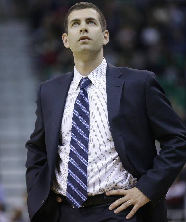 Boston Celtics head coach Brad Stevens looks at scoreboard in the second quarter of an NBA basketball game against the Utah Jazz, Monday, Feb. 24, 2014, in Salt Lake City