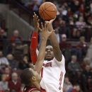 Ohio State's Deshaun Thomas, right, goes up for a shot over Nebraska's Dylan Talley during the second half of an NCAA college basketball game in Columbus, Ohio, Wednesday, Jan. 2, 2013. Ohio State won 70-44. (AP Photo/Paul Vernon)