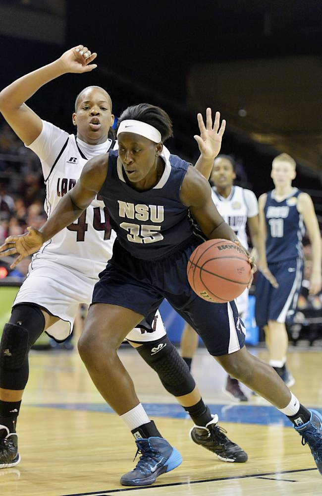 Nova Southeastern's Jasmine Wilkins drives to the basket under pressure from West Texas A&M's Chontiquah White during the first half in an NCAA women's Division II basketball tournament semifinal in Erie, Pa., on Wednesday, March 26, 2014