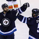 Winnipeg Jets' Jay Harrison (23) celebrates with Mark Stuart (5) after scoring against the Florida Panthers during the third period of an NHL hockey game Tuesday, Jan. 13, 2015, in Winnipeg, Manitoba The Associated Press