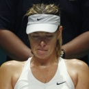 Maria Sharapova of Russia rests in between games in the second set against Petra Kvitova of the Czech Republic during their WTA Finals tennis match at the Singapore Indoor Stadium October 23, 2014. REUTERS/Edgar Su
